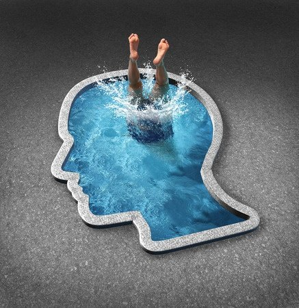 person diving into a swimming pool shaped as a human face