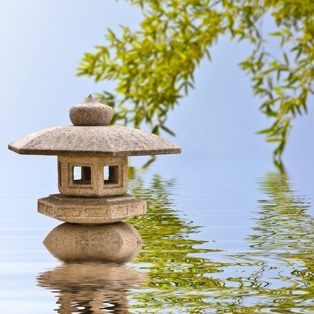 38222116 - japanese stone lantern and reflections