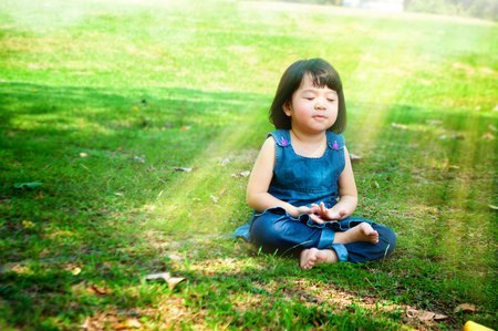 59986606 - little asian girl practicing mindfulness meditation outdoor in a park.